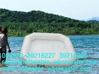 white inflatable pool