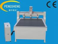 Metal engraving machine with three heads